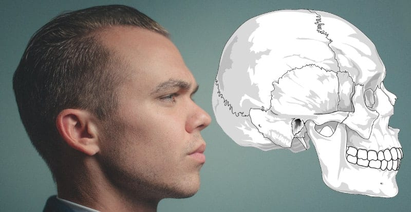 A side profile of a man with TMJ dysfunction against a teal wall and a drawing of a skull showing the temporomandibular joint