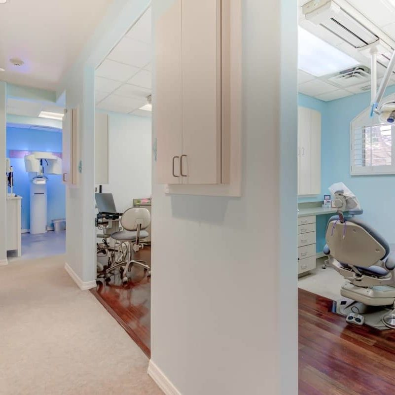 Welcome dental treatment room with dental chair and tools